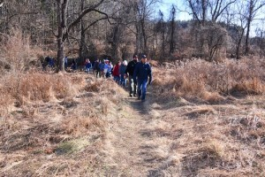 Image of a group walking a trail
