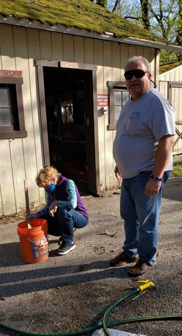 Linda and Rob mixing the chemicals and water that will keep the chestnut roots wet in their bags.
