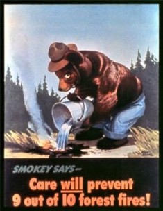 First poster of Smokey Bear pouring water on a campfire to extinguish flames